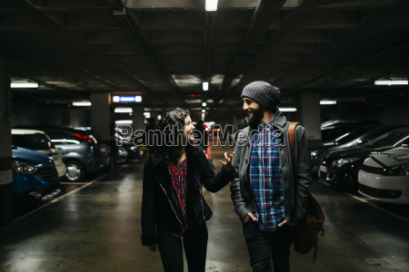 smiling young couple talking in a