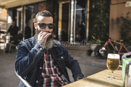 portrait of bearded man wearing sunglasses