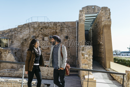 spain tarragona young couple talking as