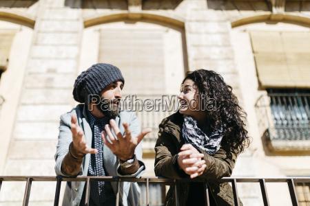 spain tarragona young couple talking city