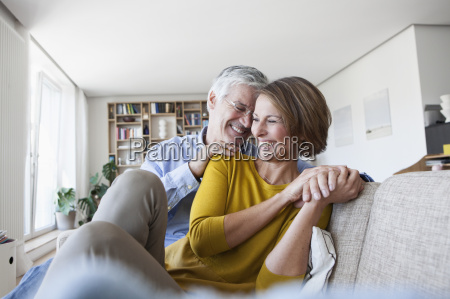 happy couple relaxing on the couch