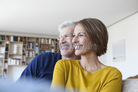 smiling couple in the living room