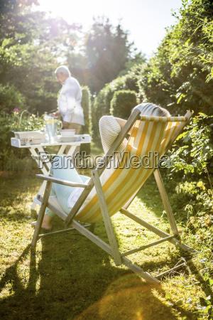 mature woman relaxing in deckchair in