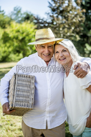 portrait of smiling elderly couple with