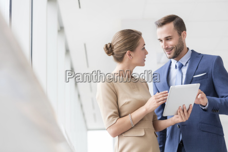 businessman and woman with digital tablet