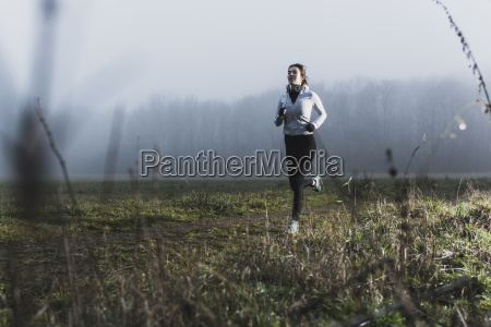 young woman jogging in nature at