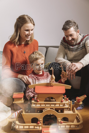 little boy and his parents playing