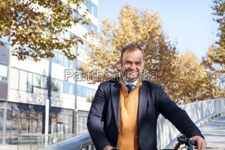 spain barcelona portrait of smiling businessman