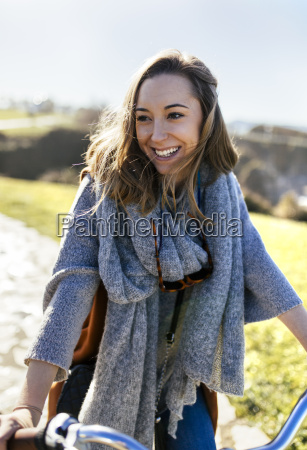 smiling young woman on bicycle