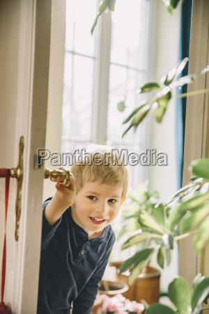 boy entering a room