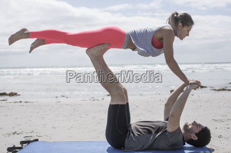 young man and woman exercising on