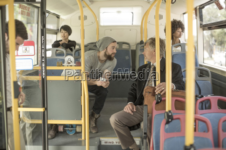 people talking in city bus