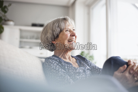 portrait of laughing senior woman sitting