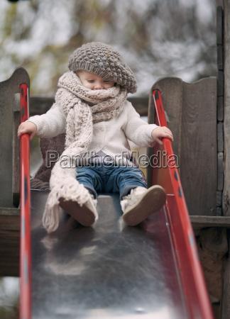 portrait of little girl wearing big