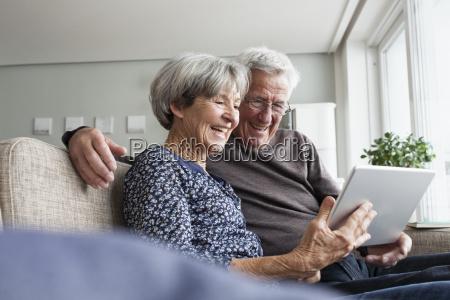 happy senior couple sitting on the