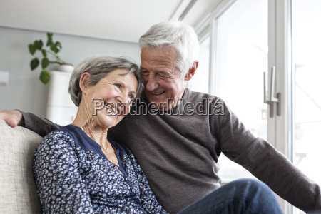 happy senior couple sitting together on