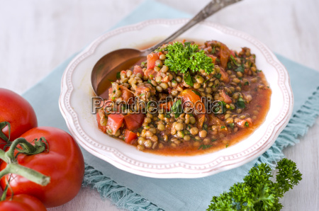 lentil tomato salad with parsley in