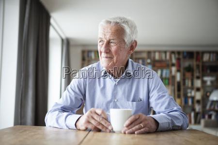 portrait of pensive senior man sitting