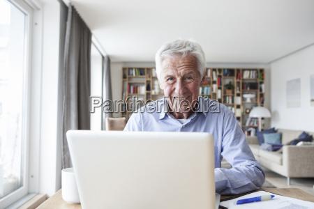 portrait of senior man sitting at