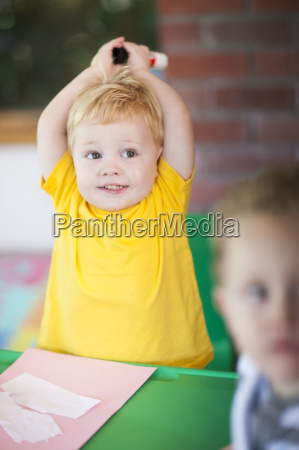 toddler playing and looking away