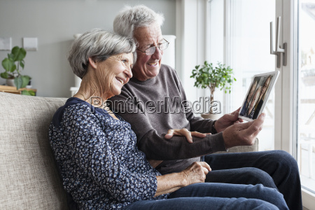 senior couple sitting in their living