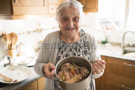 portrait of smiling senior woman showing