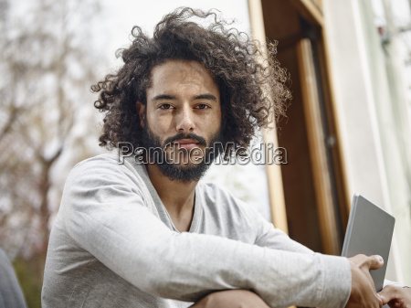 portrait of young man with digital