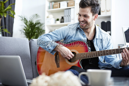 young man at home sitting on