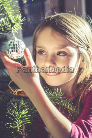 portrait of smiling girl decorating christmas