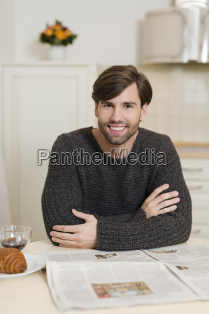 portrait of smiling man sitting at