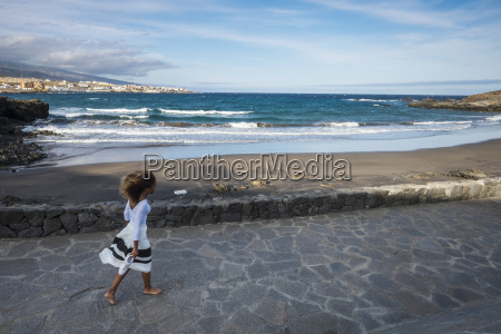 spain tenerife woman walking to the