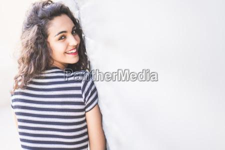 portrait of happy teenage girl looking