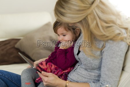 little girl sitting on her mothers
