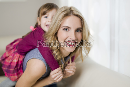 portrait of smiling woman playing with