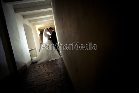 young bridal couple standing face to