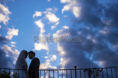 silhouette of young bridal couple standing