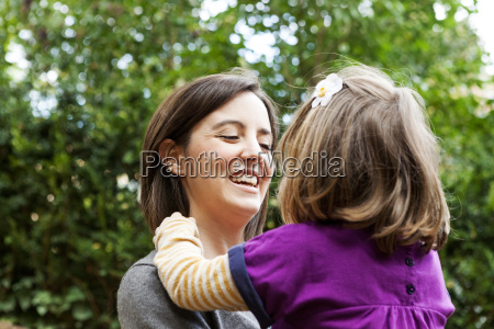 portrait of happy woman holding daughter