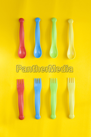 rows of colourful plastic spoons and