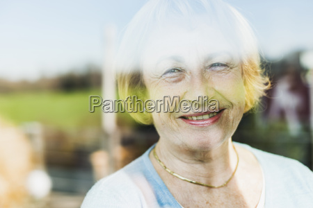 portrait of smiling senior woman behind