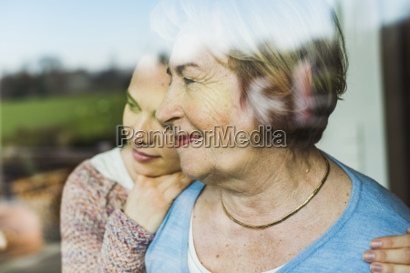 young woman and senior woman behind