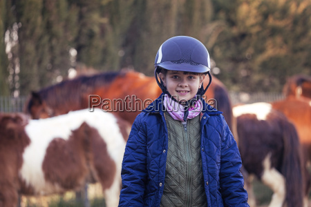 portrait of smiling girl on horse