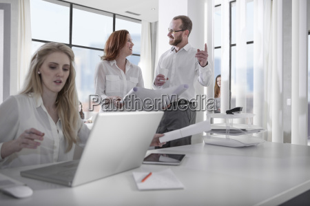 people at work in office