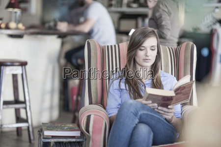 young woman sitting in coffee shop
