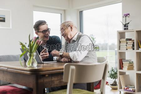 senior man and his grandson sitting