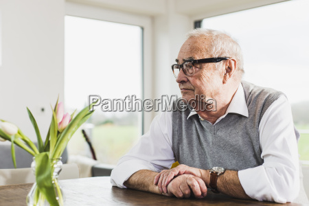 senior man sitting at his living
