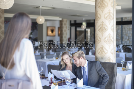 young business people meeting in restaurant