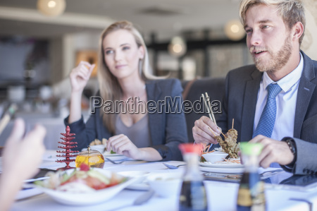 business people having lunch at restaurant