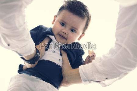 portrait of baby boy holding by