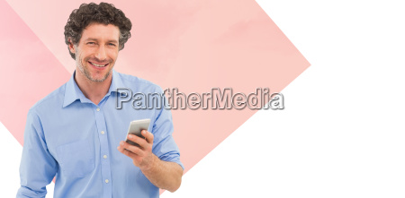 composite image of businessman holding mobile