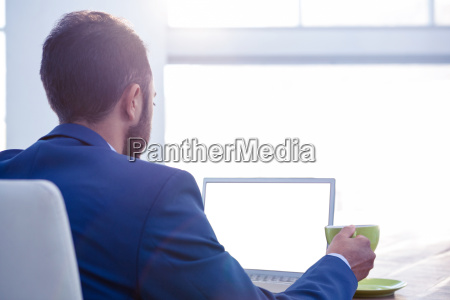 business professional holding coffee cup while